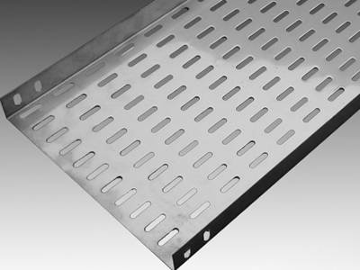 A stainless steel perforated cable tray on the gray background.