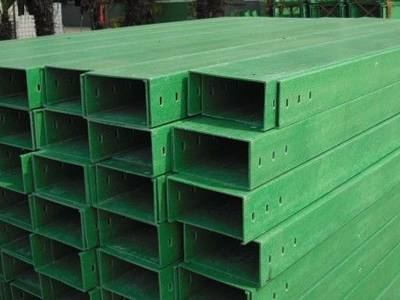 Several green color FRP cable tray on the ground.