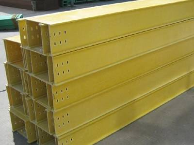 Several yellow color FRP cable tray on the ground.