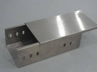 A stainless steel cable tray on the gray background.